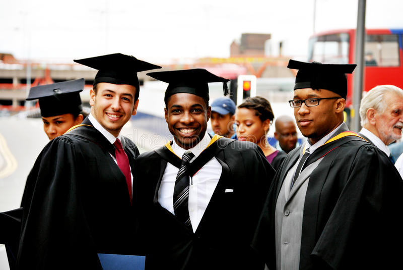 Graduates. A group of graduates smiling and feeling proud at their graduation royalty free stock images