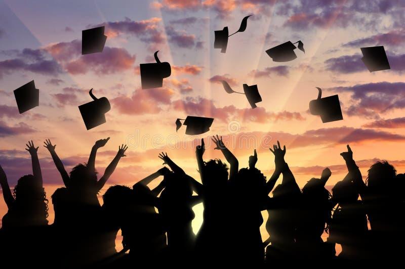 Graduates sunset throw graduate cap. Graduates of sunset from joy of throwing caps. Graduation concept stock photos