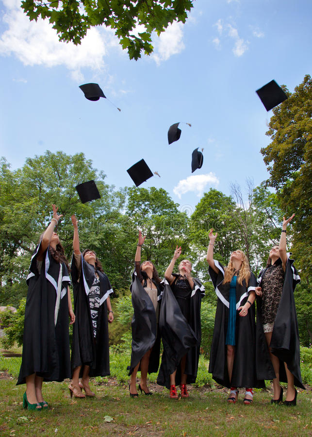 Download Graduates Throwing  Into The Sky Academic Caps Stock Image - Image: 25768299