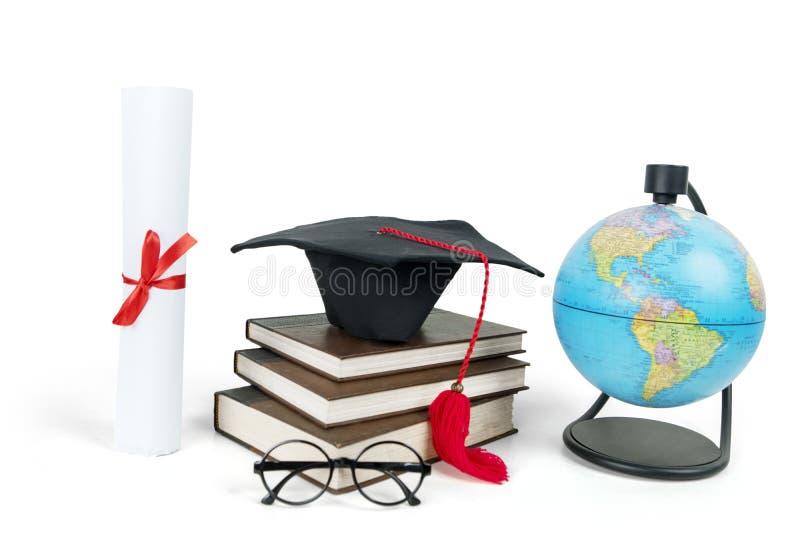 Graduatie GLB op een stapel van boeken met bol stock fotografie