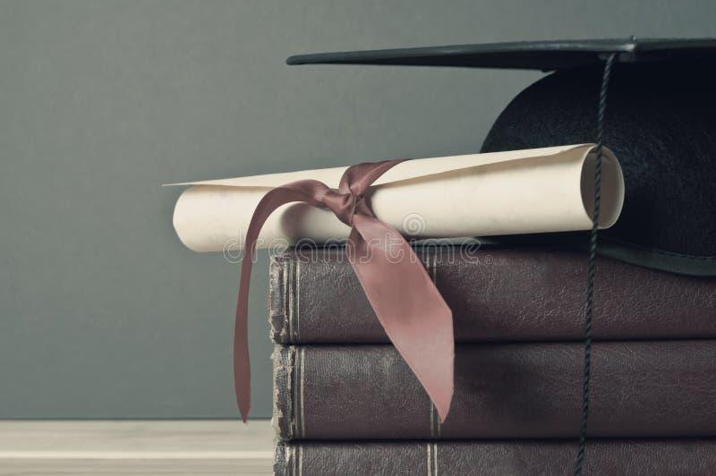 Graduatie GLB, Rol en Boeken - Langzaam verdwenen Tonen stock foto