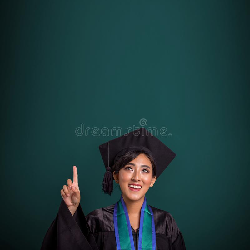 Graduating student have an idea, over chalk board stock photography