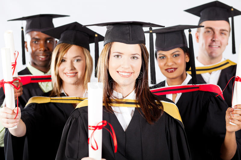 Graduation. Group of graduates in graduation gown and cap royalty free stock images
