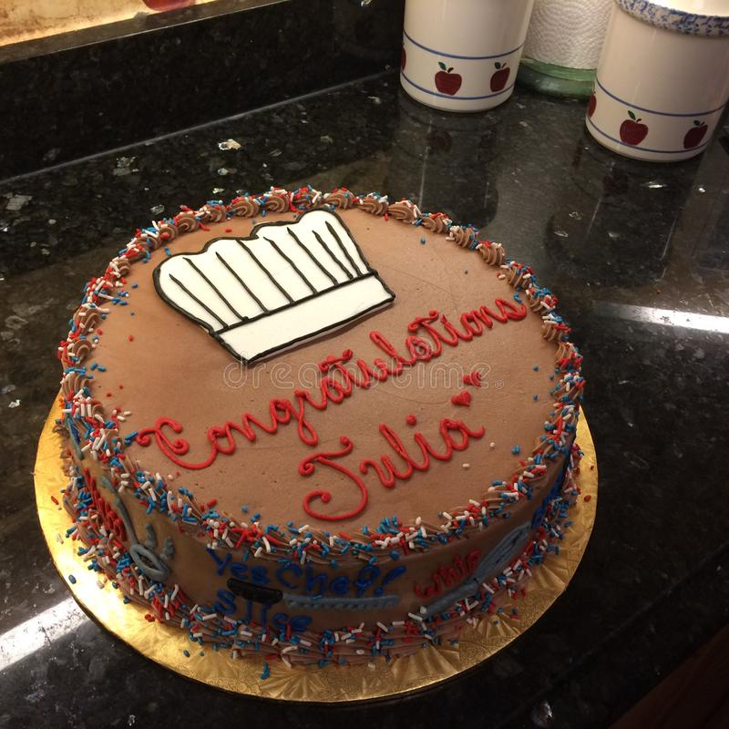 Graduation Cake for Chef with chocolate Icing royalty free stock images
