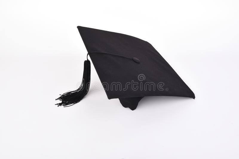 Graduation cap with back tassel isolated on white background wit stock photography