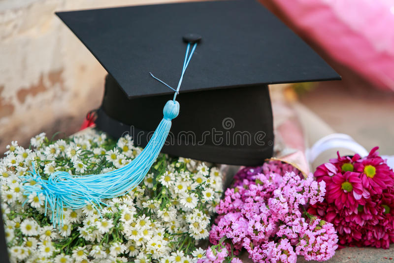 Graduation cap. And beautiful flower stock photography