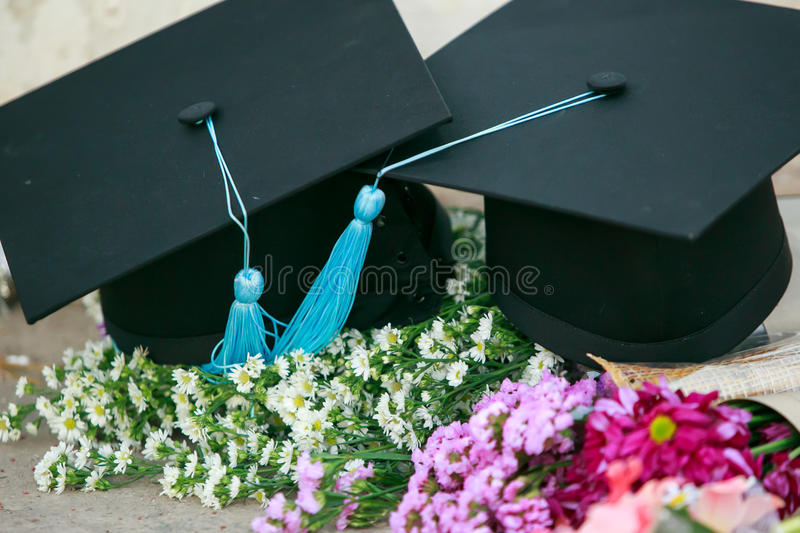 Graduation cap. And beautiful flower royalty free stock photography