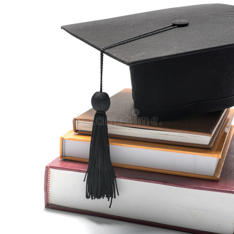Graduation cap and book royalty free stock photography