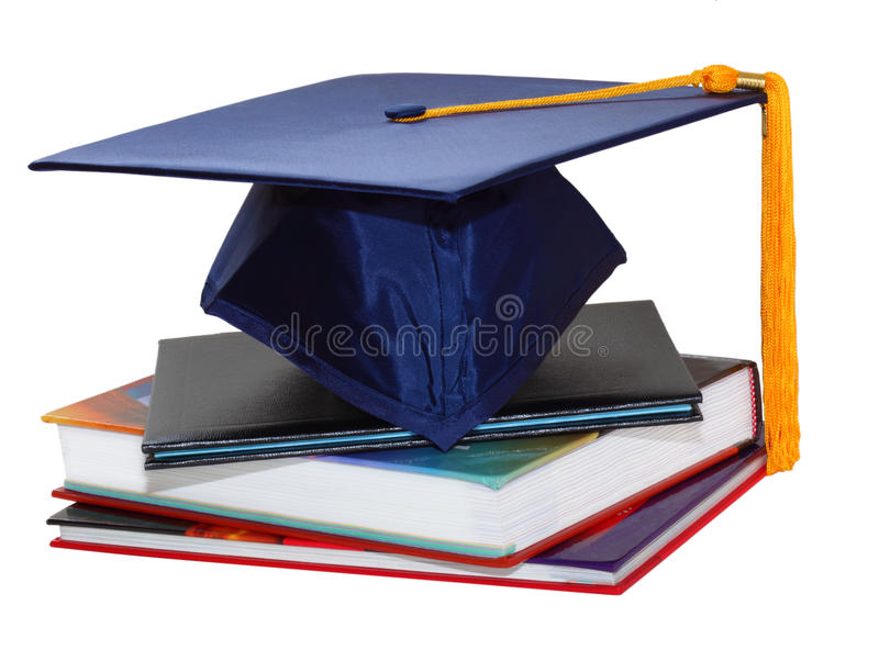 Graduation Cap and Books. Graduation cap over black leather diploma cover and books royalty free stock image