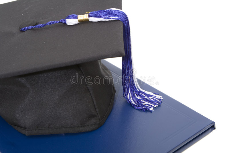 Graduation cap and diploma isolated. Against white background stock photography
