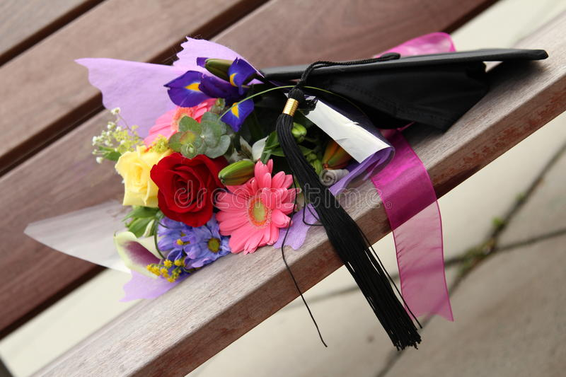 Graduation cap and flowers stock image. Image of bouquet - 35215227
