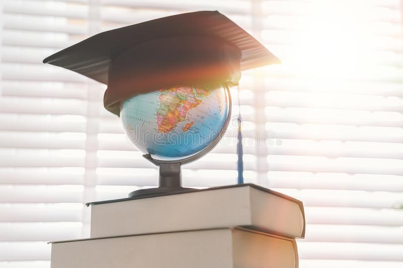 Graduation cap on top of the globe, education concept design.  royalty free stock image
