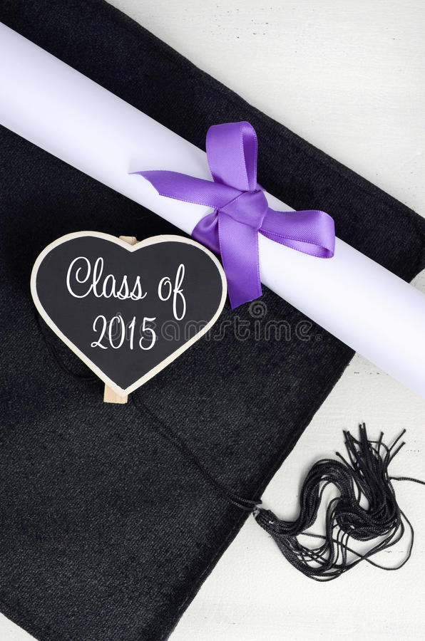 Graduation Day cap and diploma. stock photos