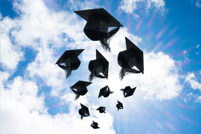 Graduation day, Images of graduation Caps or hat throwing in the royalty free stock photography