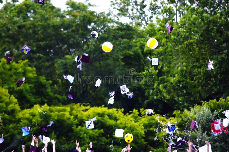 Graduation. Graduating class throwing caps into the air royalty free stock photos