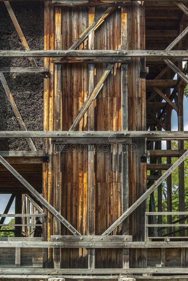 Graduation house, wooden construction and thorn wall of blackthorn bundles on which the brine trickles down and evaporates and. Forms Dornstein, a slimy coating royalty free stock photos
