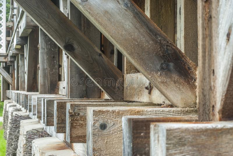 Graduation house, wooden construction and thorn wall of blackthorn bundles on which the brine trickles down and evaporates and. Forms Dornstein, a slimy coating stock images