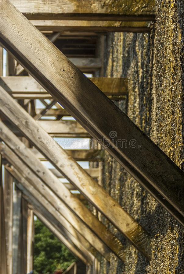Graduation house, wooden construction and thorn wall of blackthorn bundles on which the brine trickles down and evaporates and. Forms Dornstein, a slimy coating stock photos