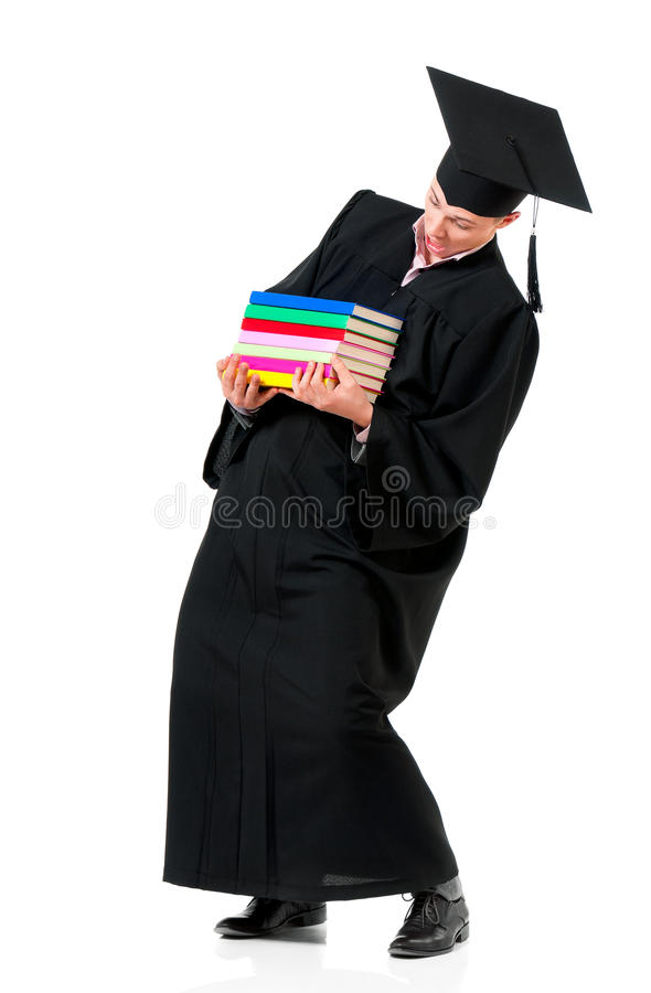 Graduation man carrying heavy books royalty free stock images