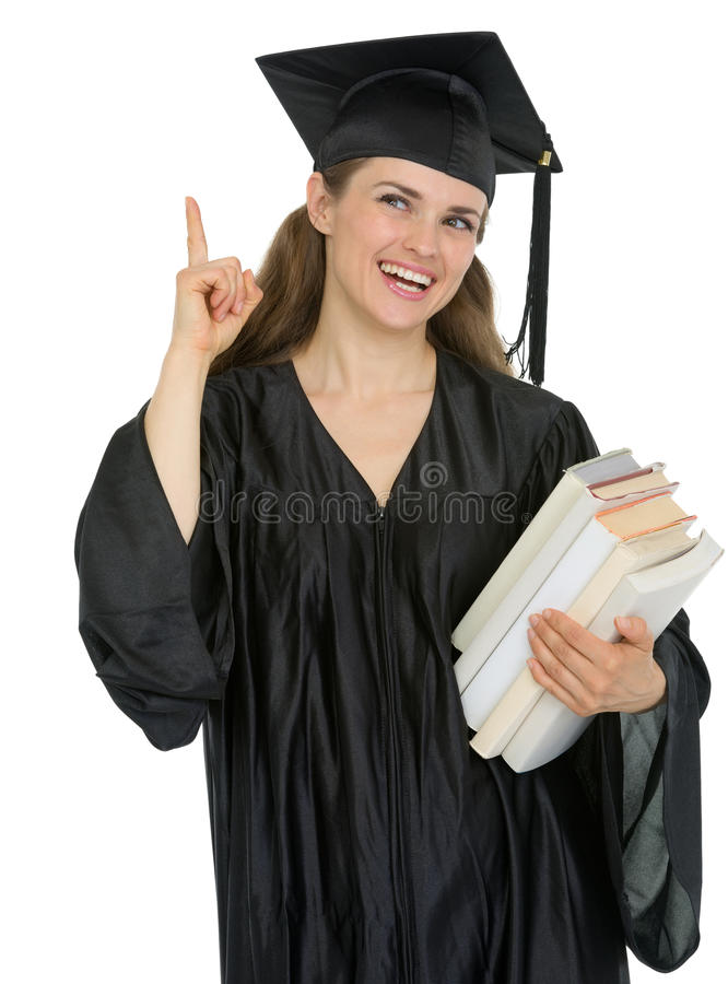 Download Graduation Student With Stack Of Books Got Idea Royalty Free Stock Image - Image: 24665396