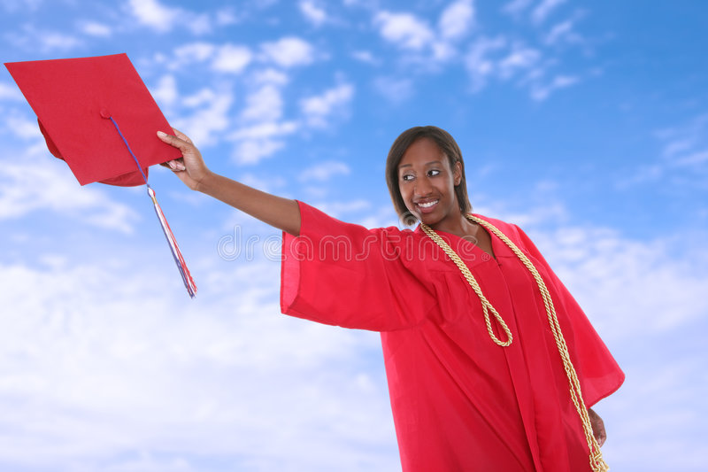 Graduation Woman. A pretty woman tossing her cap at graduation royalty free stock photos
