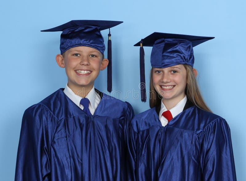 Graduierte Kinder lizenzfreie stockfotos