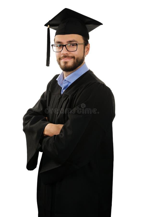 Graduiertes tragendes Kleid und Kappe des Studenten lokalisiert auf Weiß stockbilder