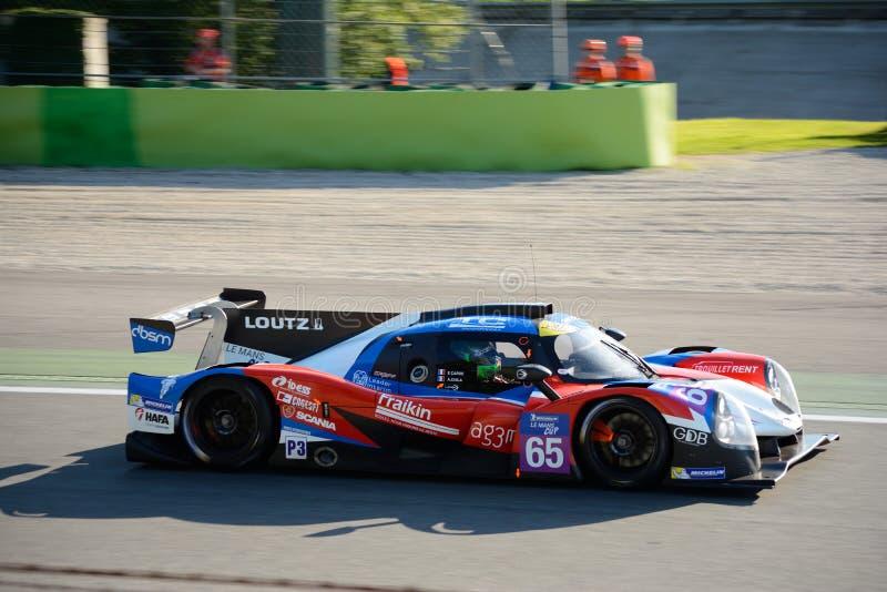 Graff que compite con el prototipo de los deportes de Ligier en la acción foto de archivo libre de regalías