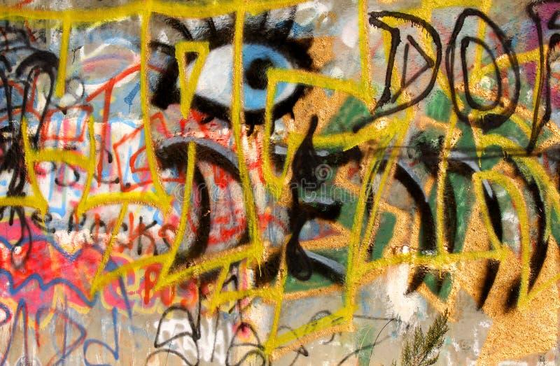 Graffiti. Water tank wall with messy colorful graffiti royalty free stock photos