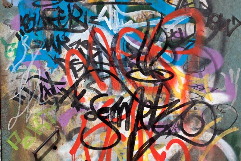 Graffiti. Colorful graffiti spraypainted on a wall royalty free stock photos
