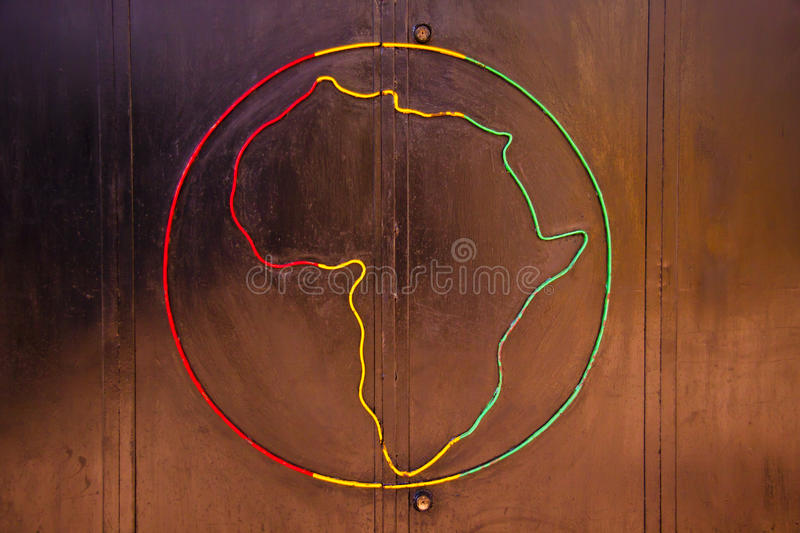 Graffiti. Picturing the globe with the african continent in the traditional african colours royalty free stock photo