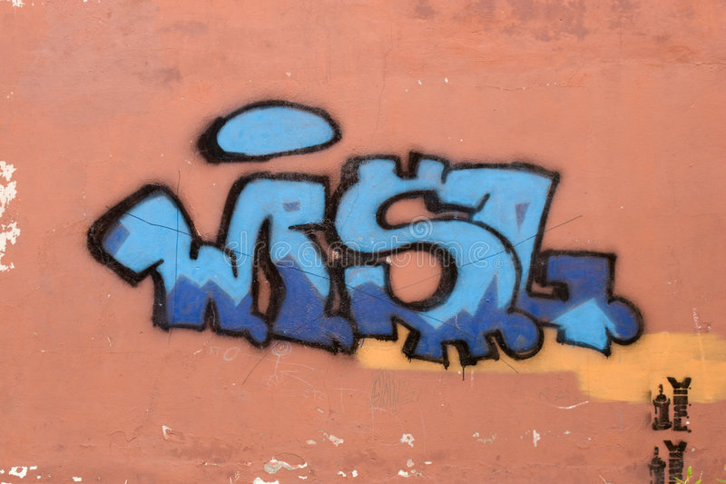 Graffiti. Color figure on a wall of a building royalty free stock photo