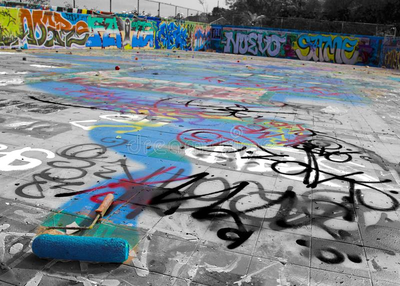 Graffiti in the abandoned Gaffey Street public pool in San Pedro, California. Black and white with color overlay of graffiti at abandoned Gaffey Street pool in stock image