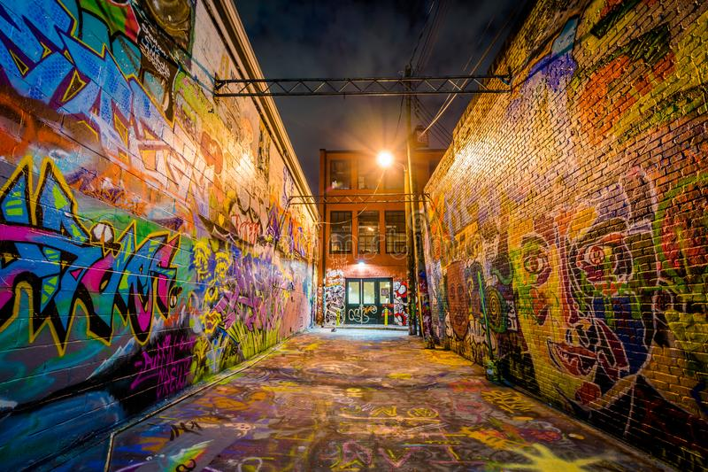 Graffiti Alley at night, in Station North, Baltimore, Maryland stock photo