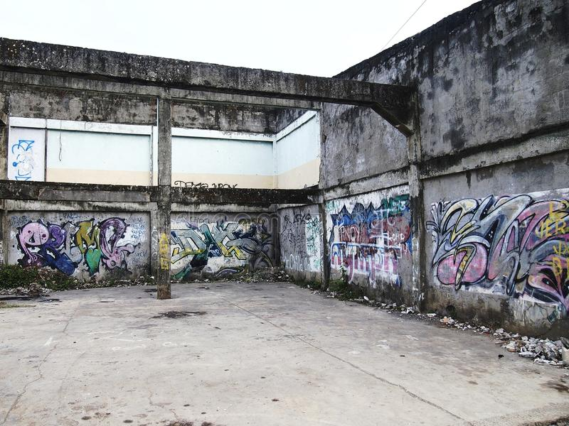 Graffiti art on a wall of an abandoned building structure in Antipolo City, Philippines. royalty free stock photography
