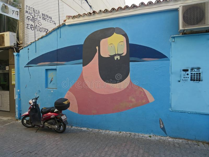 Graffiti art on the wall of a blue building in Volos, Greece. stock images