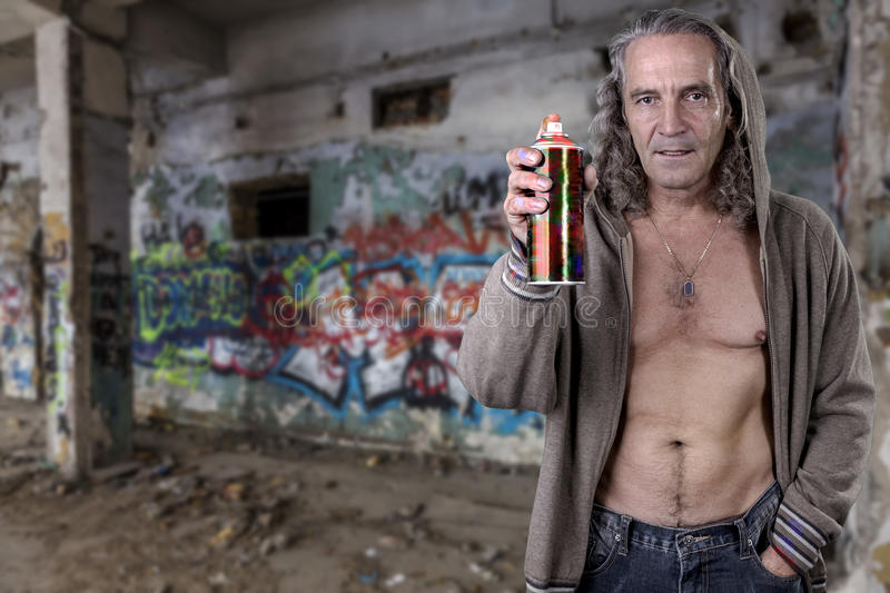 Graffiti artist illegally abandoned in a ruined building. Beautiful street art. Urban contemporary culture. In dark colors. stock image