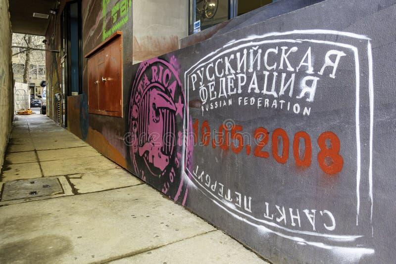 Graffiti artistically spray painted along the wall stock image