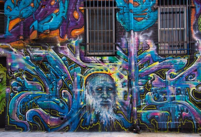 Graffiti auf einer Backsteinmauer lizenzfreie stockbilder