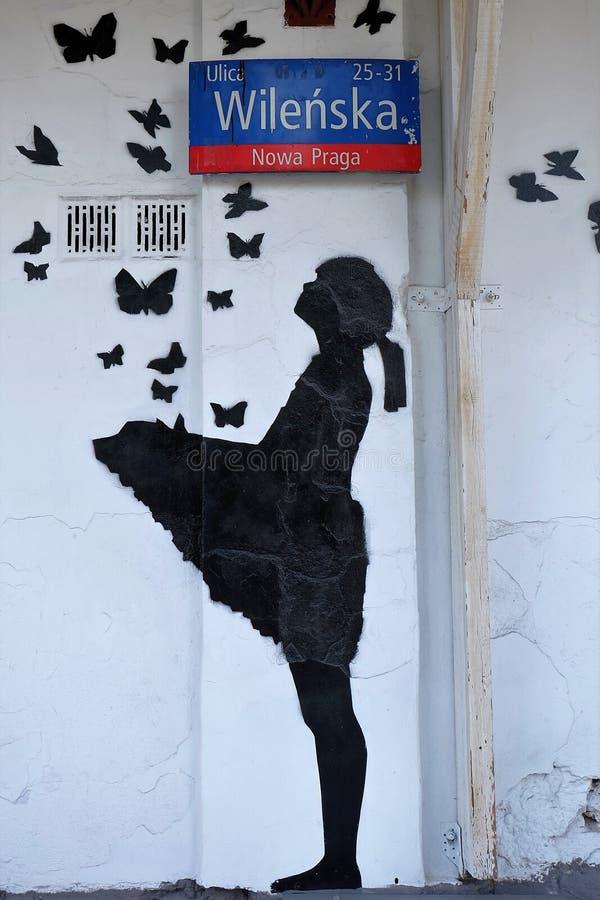 graffiti Banksy-disegnati nel distretto di Praga di Varsavia, Polonia fotografia stock