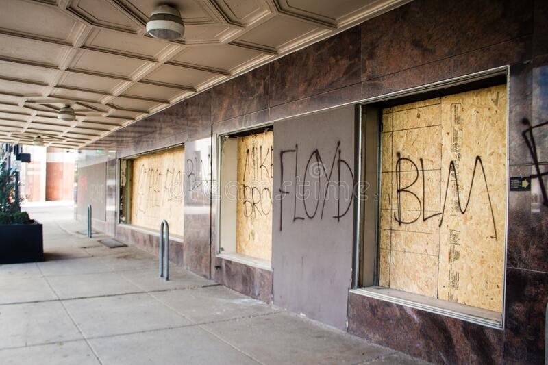 Graffiti on a Boarded Up Window in Downtown Columbus After Protests of the Death of George Floyd. Graffiti that references the death of Michael Brown and George royalty free stock images