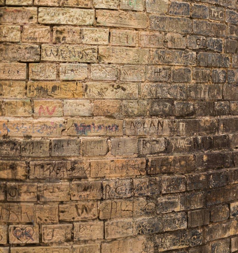 Graffiti brick stack. Graffiti on a brick tower that is located at the Japanese Tea Garden at the Brackenridge Park in San Antonio, Texas royalty free stock photos