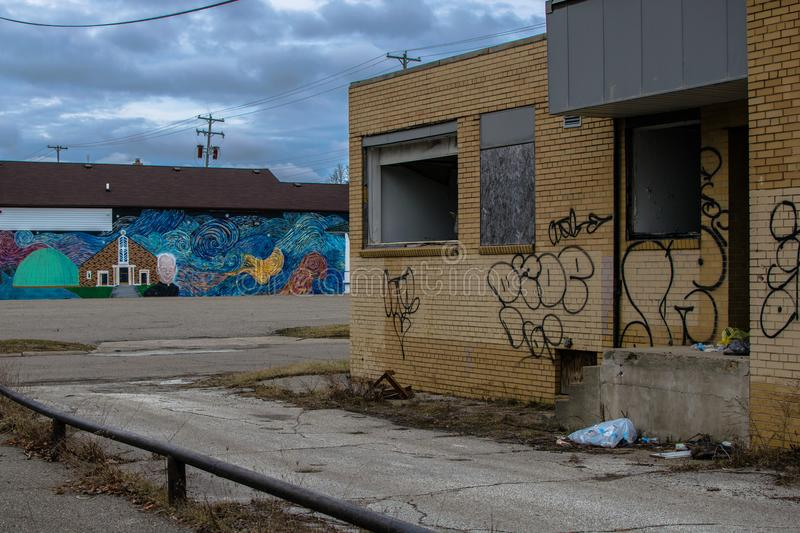 Graffiti building in flint michigan. Abandoned graffiti building in flint Michigan urban decay next to painted wall art mural stock photography