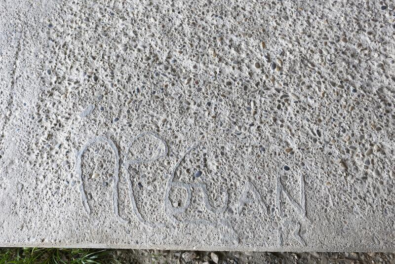 Graffiti on a cement path royalty free stock photos