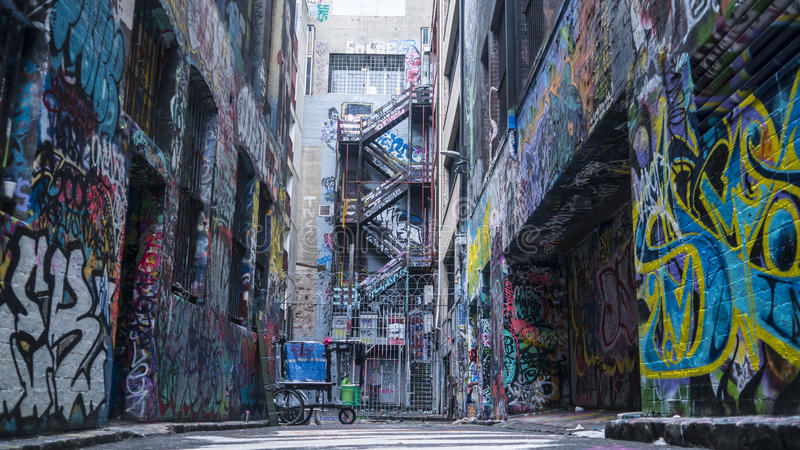 Graffiti covered walls of an alleyway royalty free stock image