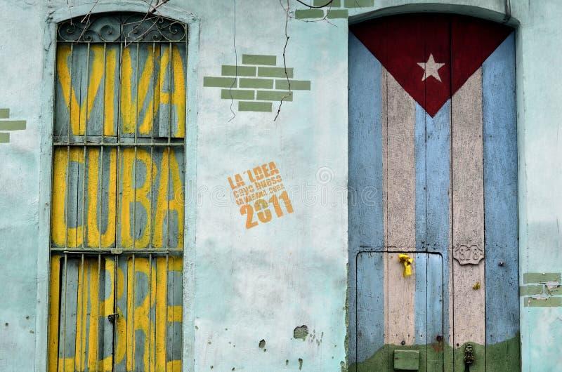 Graffiti of cuban flag and patriotic sign. Viva Cuba Libre on the old doors stock photos