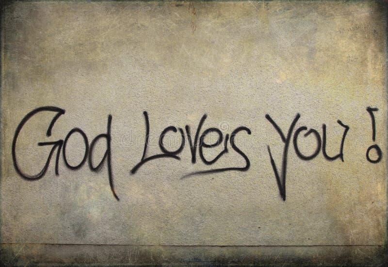 Graffiti: De god houdt van u! op een muur stock afbeeldingen