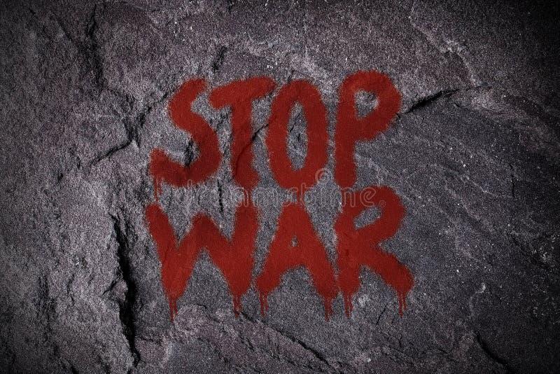 Graffiti de guerre d'arrêt sur le mur photographie stock libre de droits