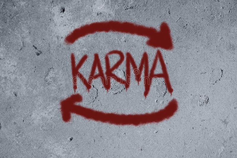 graffiti de karma sur le mur image libre de droits