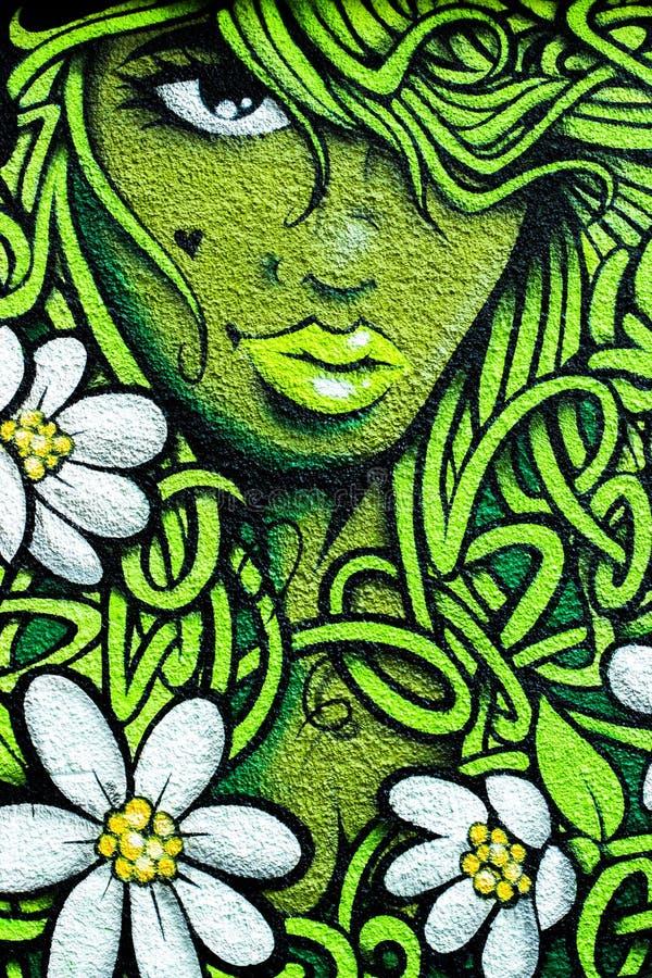 Graffiti de mur de femme photos libres de droits